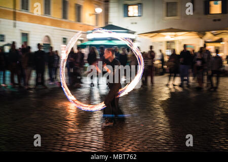 Female Fire Dancer, Street Performer in Trastevere, Rome, Italy - Stock Photo