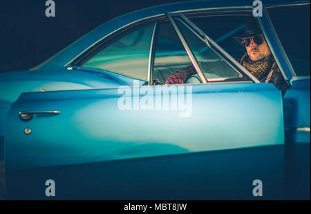 Texas Cowboy Classic Ride. Caucasian Men in His 30s Wearing Western Clothes Included Cowboy Hat Seating in His Powerful Classic Muscle Car. - Stock Photo