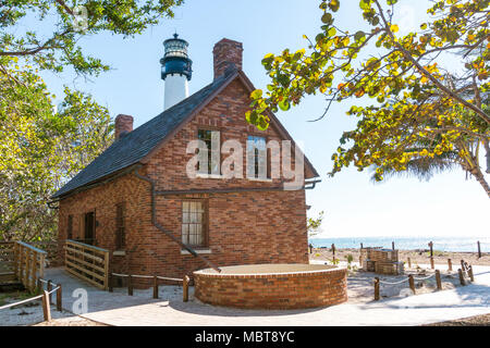 Miami,USA-march 15,2018:Key Biscayne lighthouse and old house museum on south of Miami during a sunny day. - Stock Photo