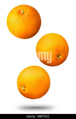 Falling oranges fruit isolated on white background - Stock Photo