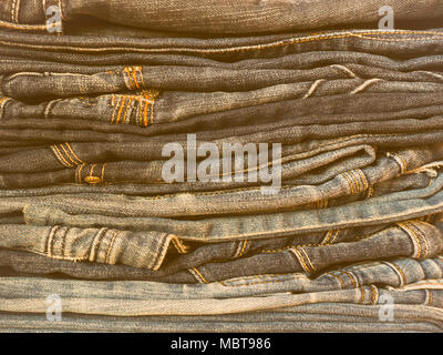 Denim texture blue jeans classic. close-up, Tinted in warm colors - Stock Photo