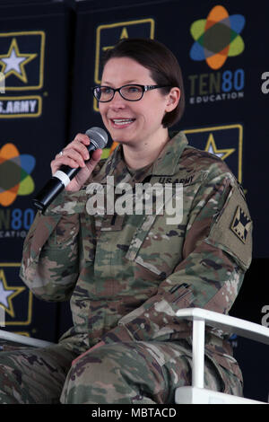 U.S. Army Reserve 1st Lt. Katherine Branham of the 416-Theatre Engineering Command takes questions with a panel of experts in front of an audience of high school students during the U.S. Army All-American Bowl week Go Army Experience Ten80 STEM workshop Jan. 5, 2018, at Sunset Station in San Antonio, Texas. STEM stands for Science, Technology, Engineering and Mathematics. Branham was invited to share her experience as a member of the Army Reserves and how that translated into her civilian career during the event. (U.S. Army photo by Sgt. Ian Valley, 345th Public Affairs Detachment/ Released) - Stock Photo