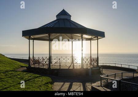 Victorian bandstand on Castle Hill in Tenby, Pembrokeshire, Wales overlooking the sea at Tenby Harbour in early morning sunshine - Stock Photo