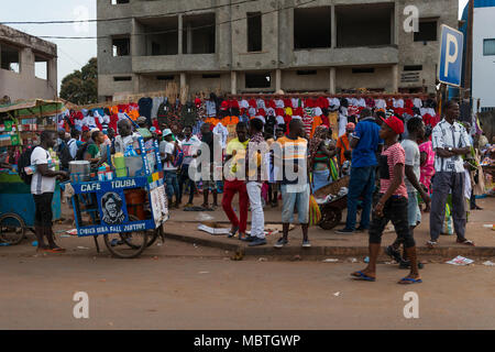 Bissau, Republic of Guinea-Bissau - January 28, 2018: Street scene in the city of Bissau with people at the Bandim Market, in Guinea-Bissau, West Afri - Stock Photo