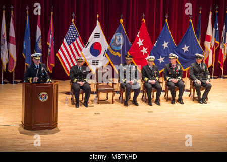 180111-N-KT595-175 Busan, Republic of Korea (Jan. 11, 2018) Rear Adm. Michael E. Boyle speaks to Sailors and families during a change of command ceremony at Commander, U.S. Naval Forces Korea Headquarters. Boyle relieved Rear Adm. Brad Cooper, becoming CNFK's 36th commander. (U.S. Navy photo by Mass Communication Specialist 1st Class Chad M. Butler/Released) - Stock Photo