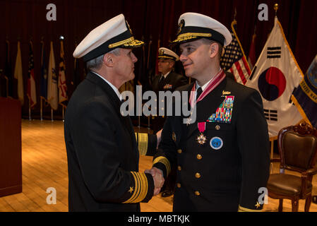 180111-N-TB148-107 Busan, Republic of Korea (Jan 11, 2018) - Vice Adm. Phil J. Sawyer, commander, U.S. Seventh Fleet presents the Legion of Merit to Rear Adm. Brad Cooper, commander, U.S. Naval Forces Korea (CNFK) during a change of command ceremony at CNFK headquarters. During the ceremony Rear Adm. Michael E. Boyle relieved Rear Adm. Brad Cooper, becoming CNFK's 36th commander. (U.S. Navy photo by Mass Communication Specialist William Carlisle/ Released) - Stock Photo