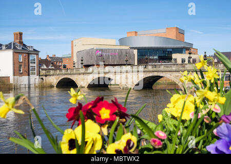 The Welsh Bridge over the River Severn with TheatreSevern beyond spring flowers in flower boxes. Shrewsbury, Shropshire, West Midlands, England, UK - Stock Photo