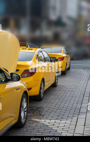 Yellow taxi on parking in Istanbul Turkey - Stock Photo