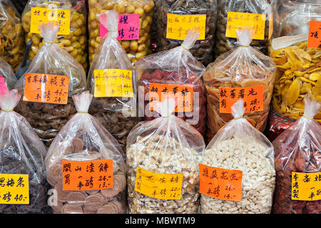 HONG KONG - MARCH 19: Dry fruits in the glocery store at Wing Lok Street on March, 19, 2013. Wing Lok street is a very popular shopping place in Hong  - Stock Photo