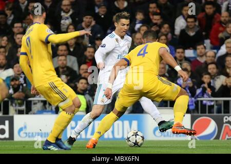 Madrid, Spain. 11th Apr, 2018. Real Madrid's Cristiano Ronaldo (C) competes during the UEFA Champions League quarterfinal second leg soccer match between Spanish team Real Madrid and Italian team Juventus in Madrid, Spain, on April 11, 2018. Juventus won 3-1. Real Madrid advanced to the semifinal with 4-3 on aggregate. Credit: Edward Peters Lopez/Xinhua/Alamy Live News - Stock Photo