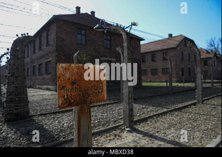 Oswiecim, Poland. 12th Apr, 2018. The main gate of the former Nazi German Auschwitz-Birkenau death camp during the 'March of the Living' at Oswiecim. The annual march honours Holocaust victims at the former Nazi German Auschwitz-Birkenau death camp in southern Poland. Credit: Omar Marques/SOPA Images/ZUMA Wire/Alamy Live News - Stock Photo
