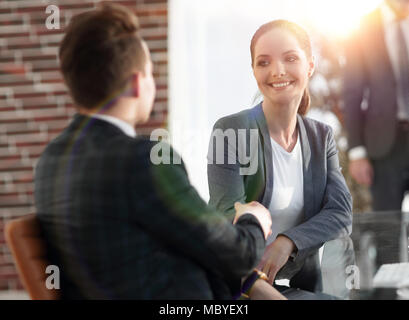 handshake Manager and the client in the office - Stock Photo