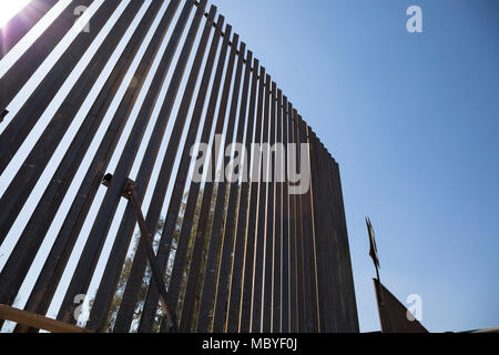 Repair work begins on a 2 1/4 mile section of Border Fence in El Centro Sector near the Calexico West Port of Entry. - Stock Photo