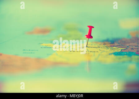 Red pushpin, thumbtack, pin showing the location, travel destination point on map. Copy space, lifestyle concept - Stock Photo