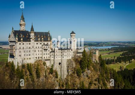 Castle Neuschwanstein in the alps - Stock Photo