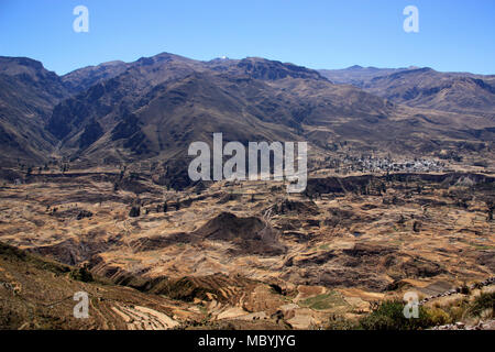 Overlooking plenty of terrace fields in the Andes Mountains in Peru. This wide valley becomes later on the Colca Canyon, the deepest canyon on Earth. - Stock Photo