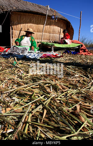 Life on the Isla los Uros, the Floating Islands of the Uros People on Lake Titicaca near Puno, Peru - Stock Photo