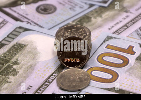 coin ruble on the background bills dollar - Stock Photo