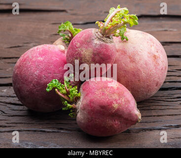 Radish taproots on the wooden background. - Stock Photo