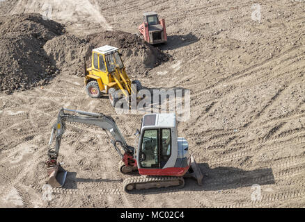 Construction site, Parked Excavators on dry dirt - Stock Photo