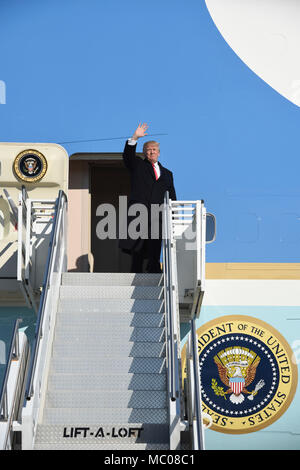 President of the United States Donald J. Trump disembarks Air Force One upon arrival at the Pennsylvania Air National Guard's 171st Air Refueling Wing in Coraopolis, Pa. Jan. 18, 2018. Greeting the president from the 171st was Col. Raymond L. Hyland, the Maintenance Group Commander and his wife Kim Hyland. Trump visited with H&K Equipment Manufacturing to discuss the benefits of the newly passed U.S. tax reform. Accompanying the president on his visit was his daughter Ivanka Trump. The president took time to shake hands with Guardsmen and guests before departing. (U.S. Air National Guard Photo - Stock Photo
