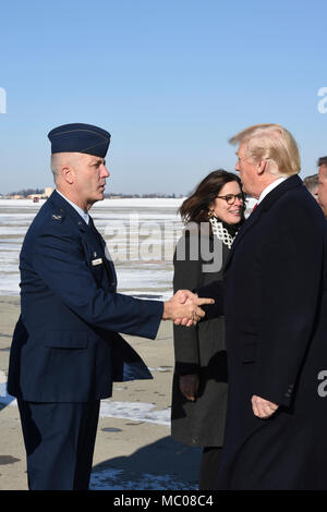 Col. Raymond L. Hyland, the Maintenance Group Commander and his wife Kim Hyland greet President Donald J. Trump upon arrival at the Pennsylvania Air National Guard's 171st Air Refueling Wing in Coraopolis, Pa. Jan. 18, 2018. (U.S. Air National Guard Photo by Senior Airman Kyle Brooks) - Stock Photo
