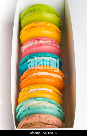 Close up of a box full of colorful macaroons. - Stock Photo