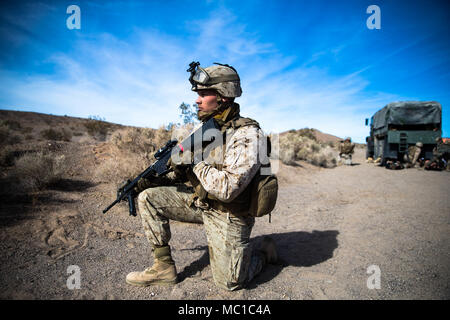 Cpl. Caleb Hattabaugh, landing zone commander, Combat Logistics Battalion 3, provides security during the first responders' lane training on range 114 at Marine Corps Air Ground Combat Center, Twentynine Palms, Calif., Jan. 18, 2018, as a part of Integrated Training Exercise 2-18. The purpose of ITX is to create a challenging, realistic training environment that produces combat-ready forces capable of operating as an integrated MAGTF. (U.S. Marine Corps Photo by Pfc. William Chockey) - Stock Photo