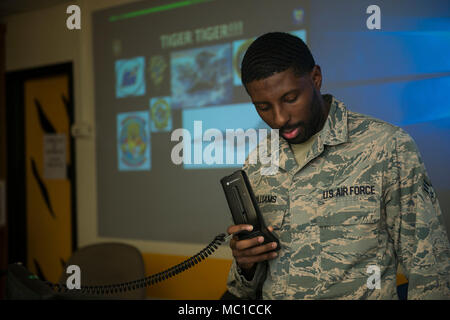 U.S. Air Force Senior Airman Jeffrey Williams, 79th Fighter Squadron squadron aviation resource management (SARM) journeyman, sends information over the radio at Shaw Air Force Base, S.C., Jan. 18, 2018. SARMs use the radio to communicate information around the flightline concerning jet maintenance. (U.S. Air Force photo by Senior Airman Destinee Sweeney) - Stock Photo