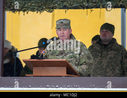 Yavoriv, Ukraine – Col. Dennis Deeley, the 27th Infantry Brigade Combat Team (forward) commander, delivers a speech to Soldiers belonging to the Ukrainian Army's 3rd Battalion, 14th Mechanized Brigade during a ceremony here Jan. 22. During the next two months, more than 200 New York Army National Guard Soldiers stationed in Ukraine will help train and mentor the 3-14th as it pursues its goal of achieving NATO interoperability. (U.S. Army photo by Sgt. Alexander Rector) - Stock Photo
