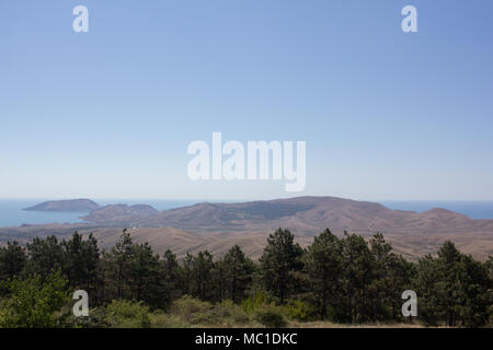 A view of the mountains and the sea on a summer day. Deserted landscape. - Stock Photo