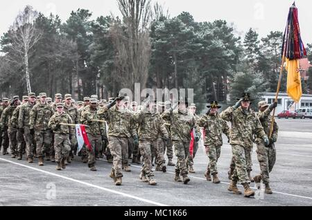 U.S. Soldiers from 5th Squadron, 4th Regiment, 2nd Armored Brigade Combat Team, 1st Infantry Division, march in formation during a farewell ceremony hosted by the Polish 10th Armored Cavalry Brigade in Swietoszow, Poland, Jan. 22, held to bid farewell to the squadron, as they transition their operations to Grafenwoehr, Germany for scheduled training. (Polish Land Forces photo by Pvt. Natalia Wawrzyniak) - Stock Photo