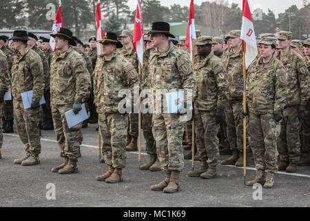 U.S. Soldiers from 5th Squadron, 4th Regiment, 2nd Armored Brigade Combat Team, 1st Infantry Division, stand in formation during a farewell ceremony hosted by the Polish 10th Armored Cavalry Brigade in Swietoszow, Poland, Jan. 22, held to bid farewell to the squadron, as they transition their operations to Grafenwoehr, Germany for scheduled training. (Polish Land Forces photo by Pvt. Natalia Wawrzyniak) - Stock Photo