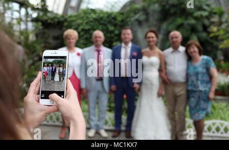 St. Petersburg, Russia, 18 june 2015 wedding photos on a smartphone - Stock Photo
