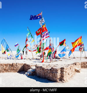 Flags at the Salar de Uyuni, Bolivia, the largest salt flat in the world - Stock Photo