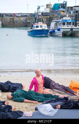 Mannequins waiting to be used in a GMICE (Good Medicine in Challenging Environments) major incident exercise in Newquay Harbour in Cornwall. - Stock Photo