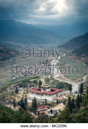 Late afternoon view of Rinphung Dzong, which is located in the Paro Valley, Bhutan. The Buddhist monastery is also known as Paro Dzong. - Stock Photo
