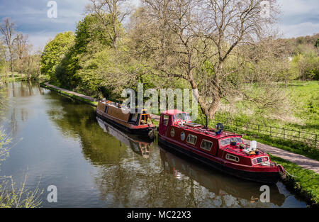 Watford, UK - April 17, 2014: View of Grand Union Canal , in Cassiobury Park, with two beautiful houseboats. - Stock Photo