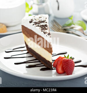 Three chocolate layered mousse cake - Stock Photo