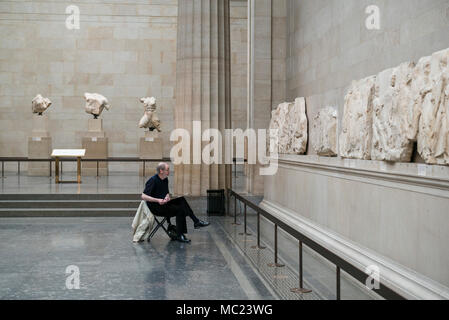 London. England. Artist sketching section of the Parthenon Frieze (Elgin Marbles) in the Duveen Gallery of the British Museum.  Parthenon Frieze (Elgi - Stock Photo