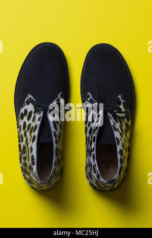 spotted black and white Clark shoes, against a bright background, top view - Stock Photo