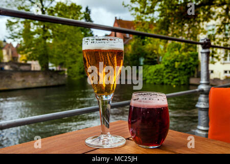 Two glasses of belgian beer standing on the table - Stock Photo