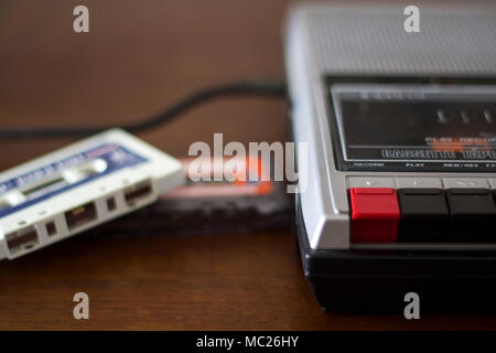 Retro cassette tape player with audio cassette tapes on the side - Stock Photo