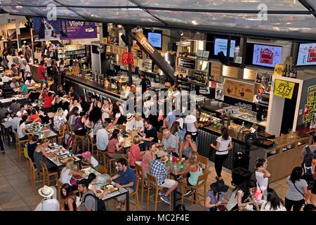 bar & crowded seating area of food court The Mercato Centrale or Mercato di San Lorenzo - Central Food Market  Florence - Tuscany, Italy - Italy - Stock Photo