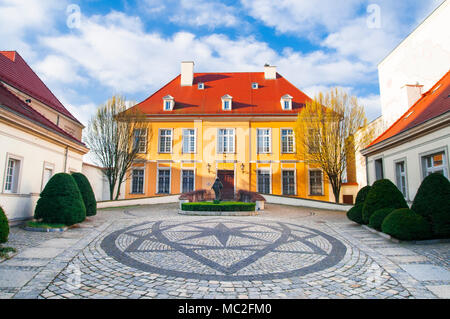 Archbishop's Palace in Wroclaw with the Sculpture of Virgin Mary,a nd the pattern on the stone pavement in Ostrow Tumski, Wroclaw, Poland, April 2018. - Stock Photo