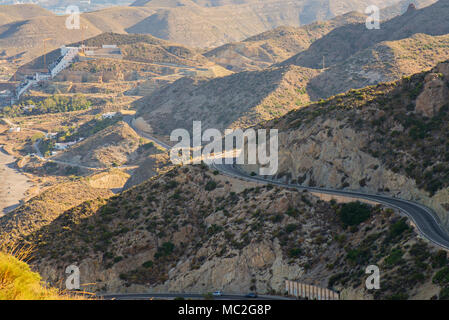 Aerial above view of a rural landscape with a curvy road running through it in Spain, Andalusia - Stock Photo