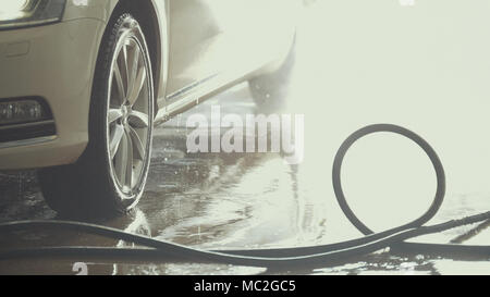 The car is covered by the water after car washing - Stock Photo