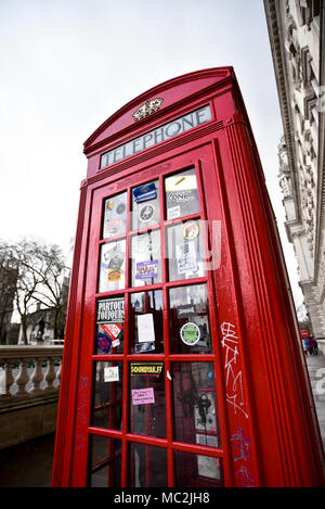 Traditional British Red Phone Box on Pavement - Westminster Square - London UK - Stock Photo