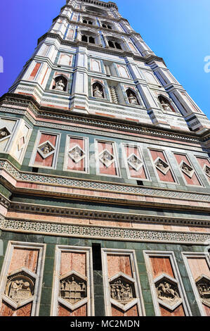 Giotto's Belltower or Campanile, Florence Cathedral. Beautiful building with red and green marble panels, bas-reliefs and statues reaches skywards - Stock Photo