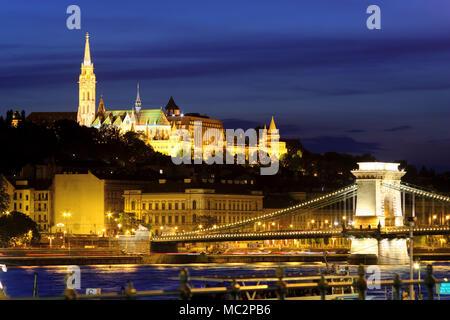 Chain bridge, Matthias Church and Fishermen's Bastion at night, Budapest - Stock Photo